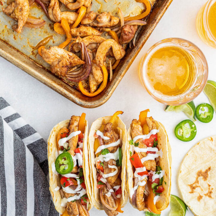 3 chicken fajitas with toppings.
