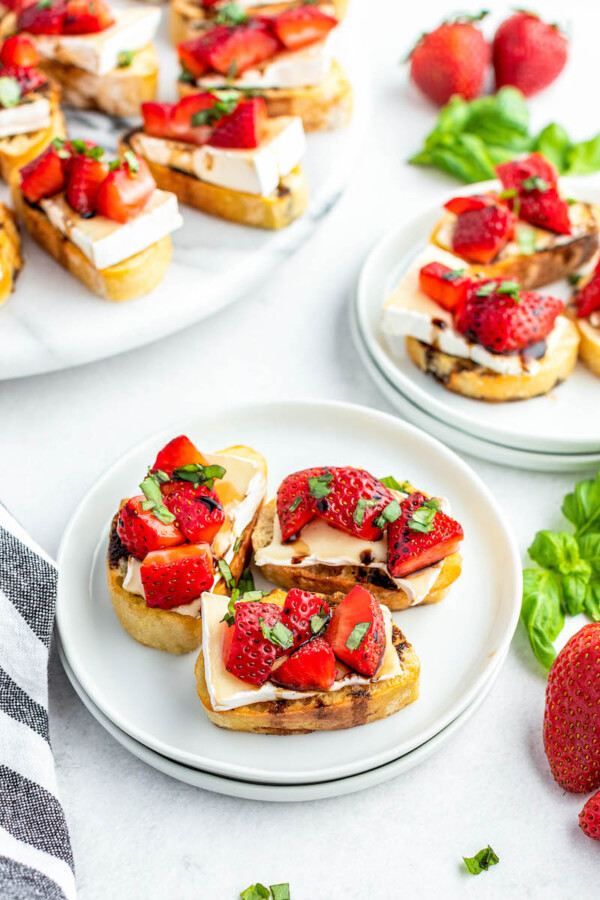 Plates of strawberry brie crostini.