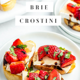 Up close image of strawberry and brie on top of a crostini toast.