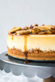 Bananas foster cheesecake on a cake platter.