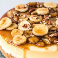 Bananas foster cheesecake topped with banana slices.