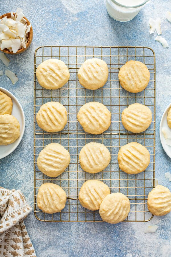 Coconut cookies are cooling on a wire cooling rack.