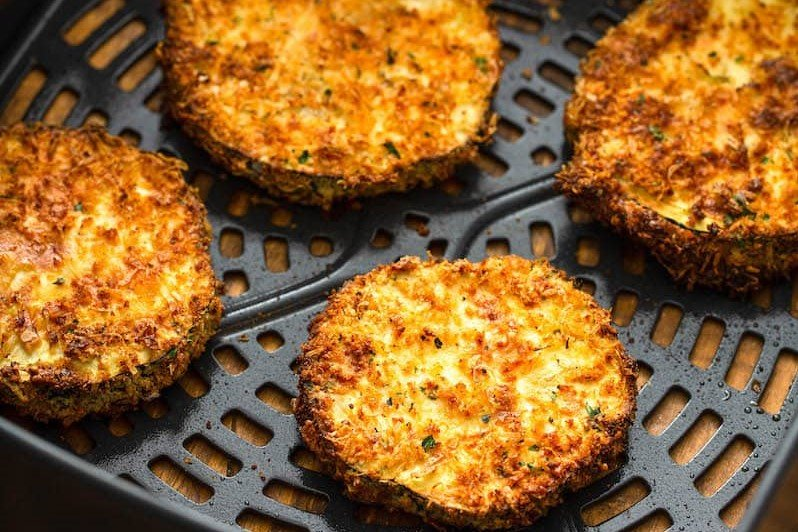 Golden-browned breaded eggplant slices in an air fryer