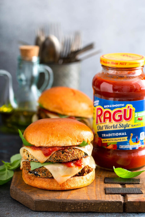 Eggplant Parmesan Sandwiches sit next to a jar of RAGU