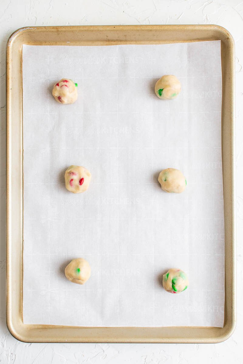 Cookie balls on a pan.