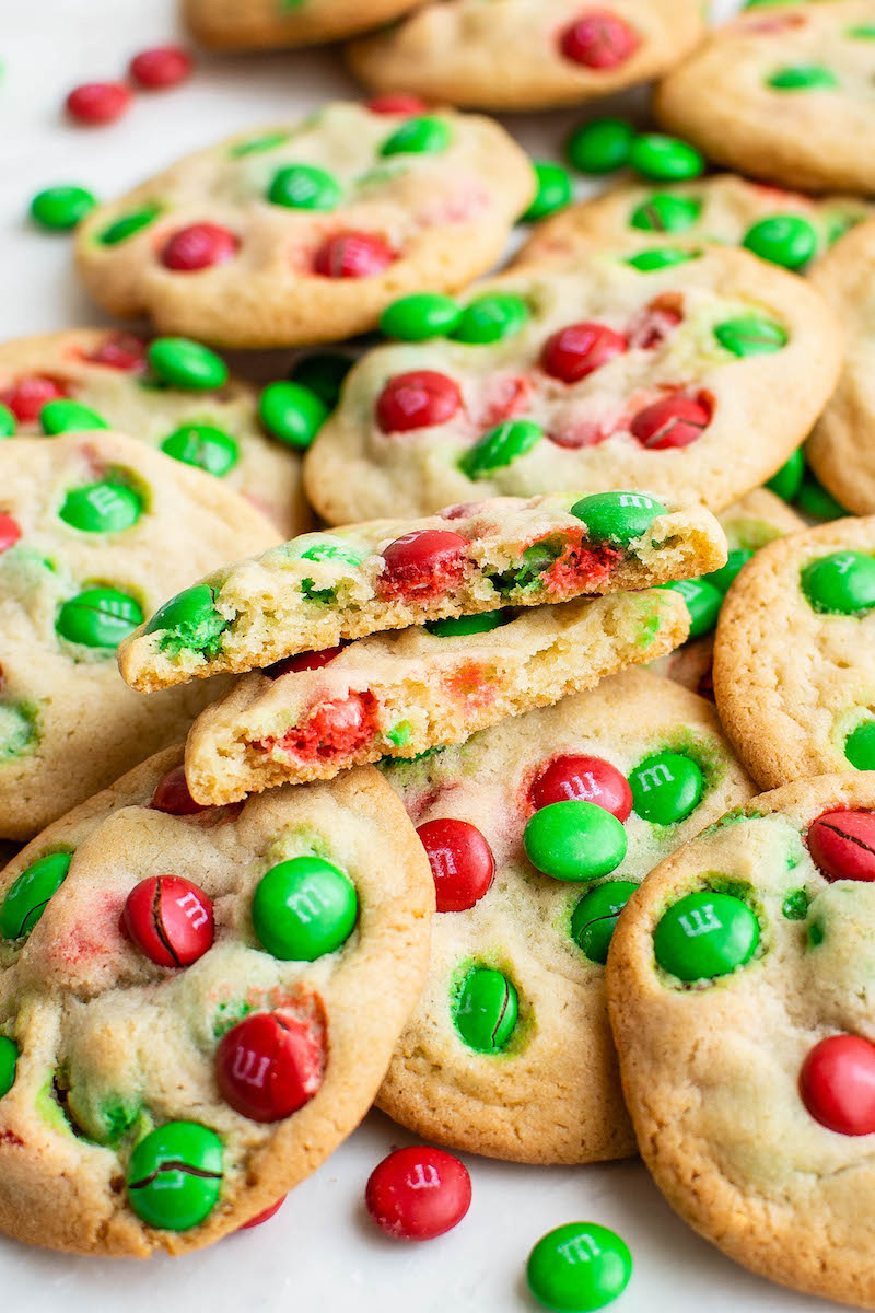 Pile of red and green M&M cookies.