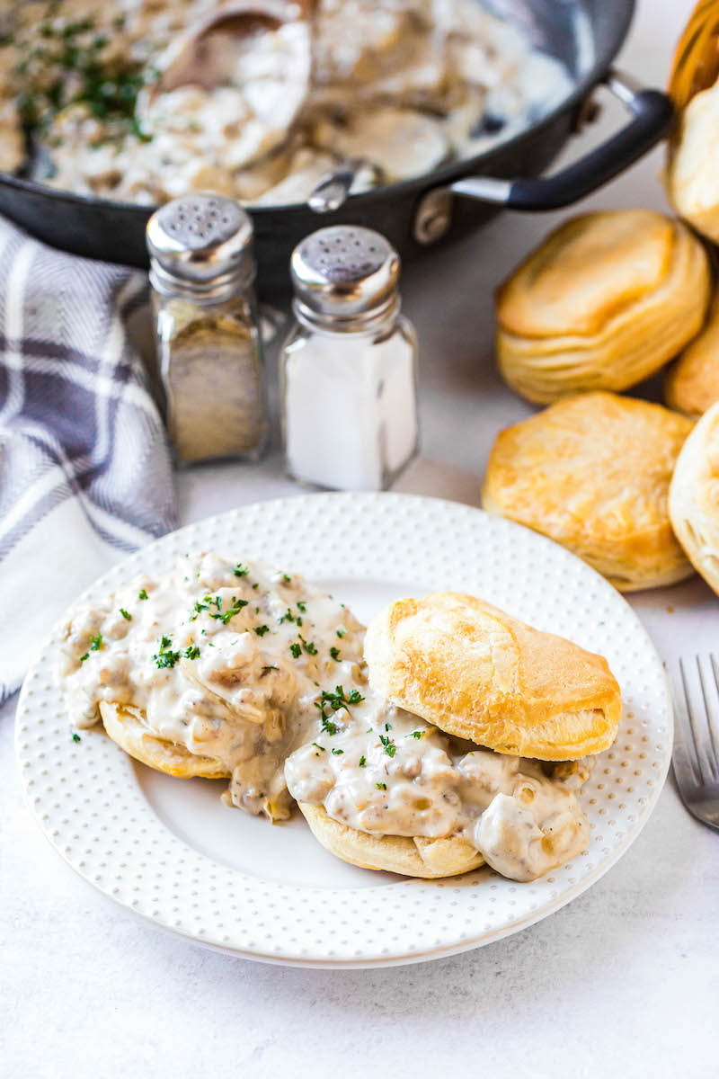 Biscuits and gravy on a plate.