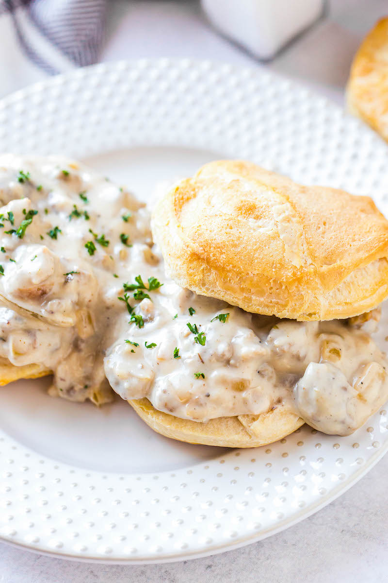 Two biscuits with sausage gravy.