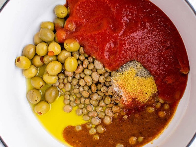 Top view of ingredients for Arroz Con Gandules in a stock pot