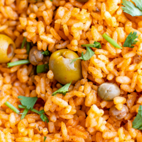 Up close image of arroz Con Gandules with cilantro on top.