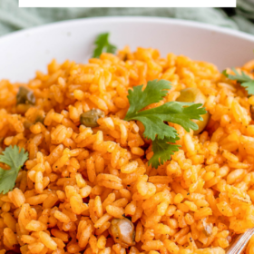 Up close image of arroz con gandules in a bowl with a spoon.