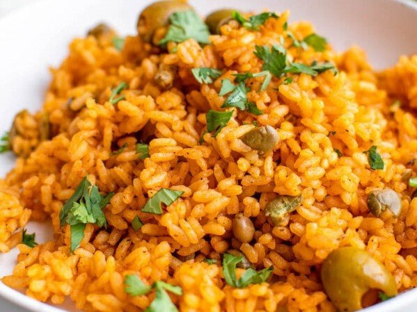 Close-up of a serving of Arroz con Gandules topped with fresh cilantro