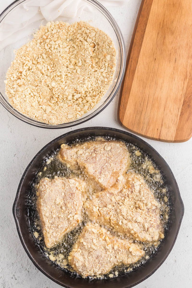Breaded chicken in a frying pan.