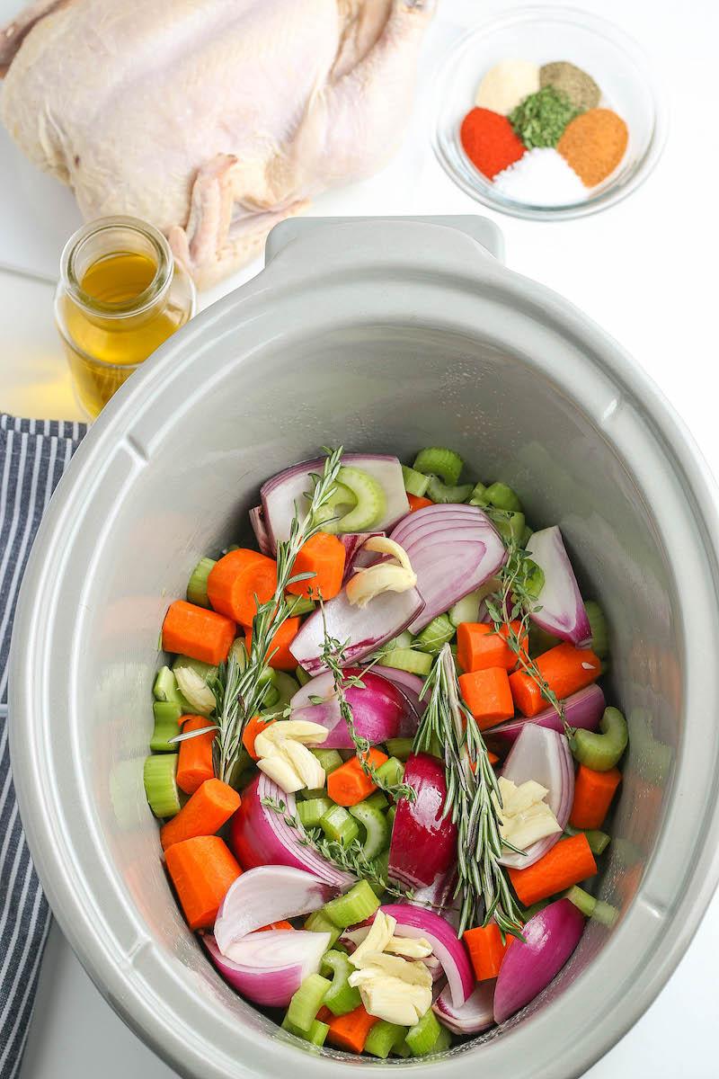 Chopped veggies in a crockpot.
