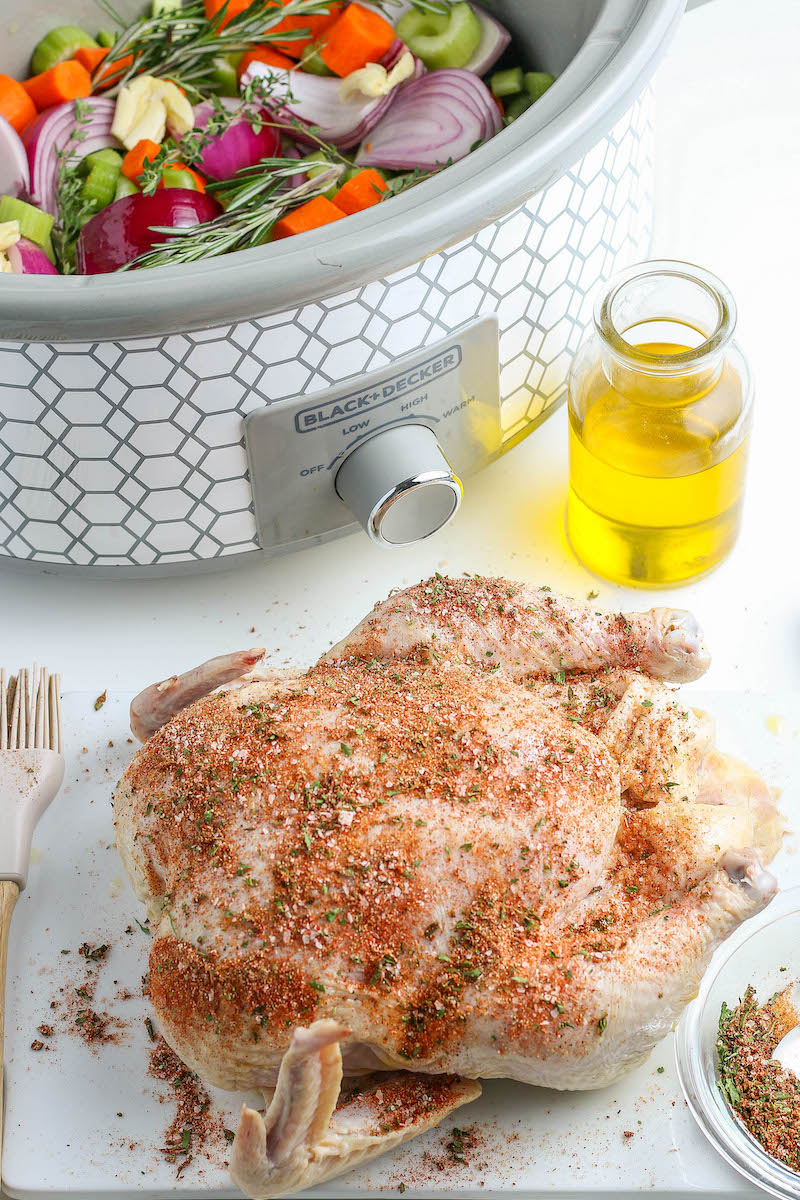 Seasoned uncooked whole chicken.