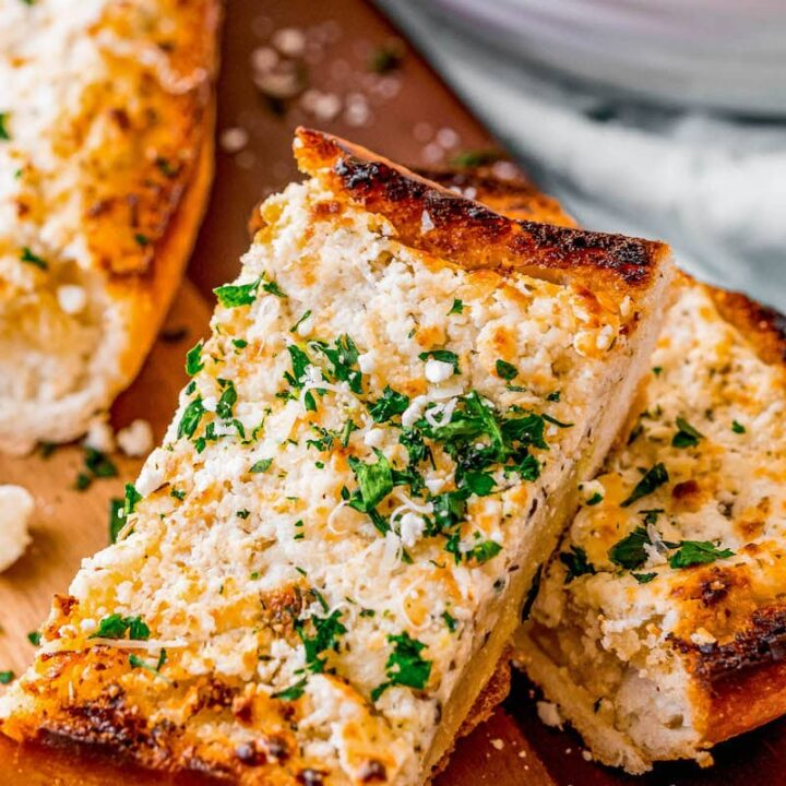 Slices of goat cheese garlic bread.
