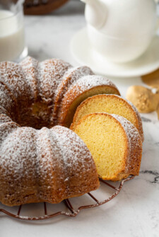 The orange rum bundt cake is sliced into, revealing a perfectly baked center.
