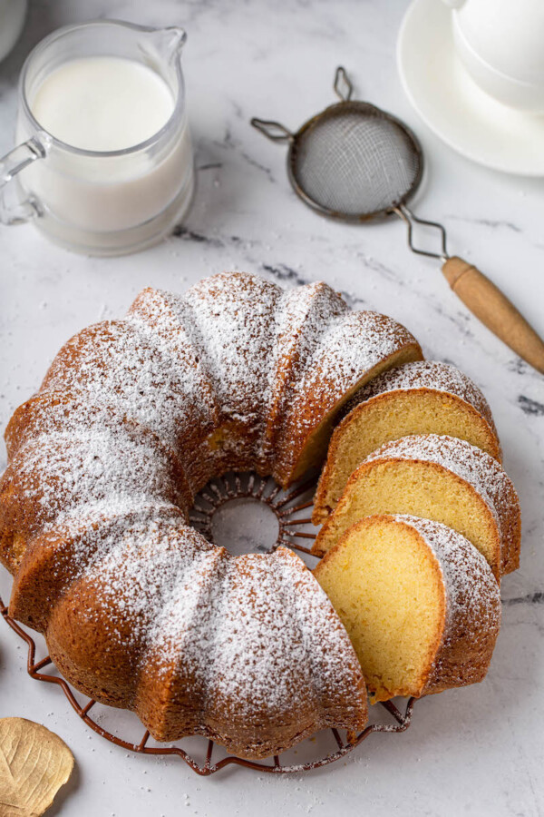 A bundt cake is sliced into even pieces.