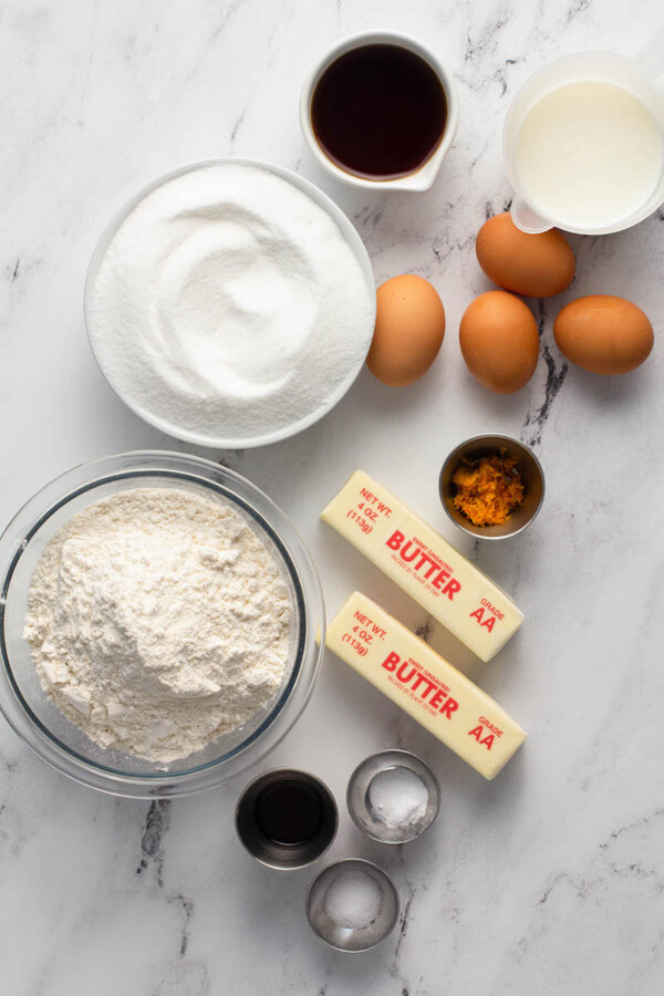 The ingredients for bundt cake are placed on a white surface.