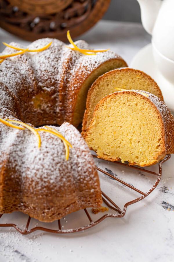 Orange zest and powdered sugar garnish a bundt cake.