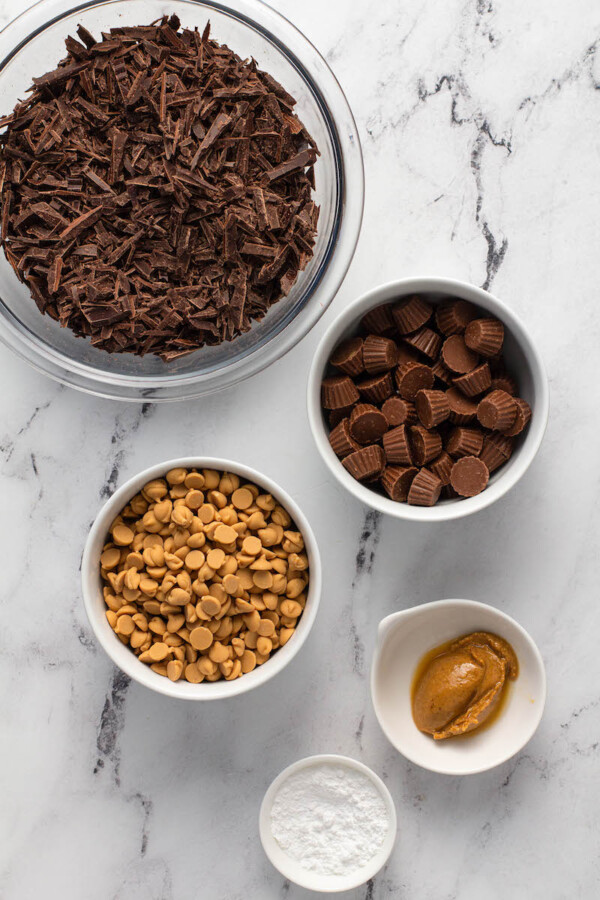 The ingredients for bark are in separate bowls on a marble surface.