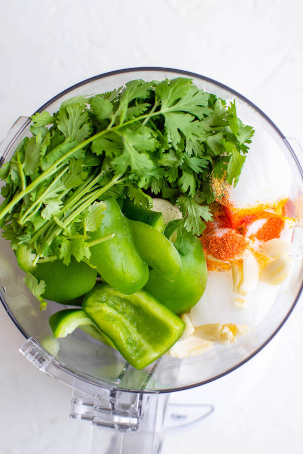 The vegetables are in a blender, ready to be blended together.