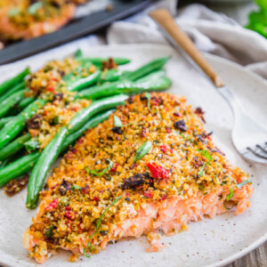 Plate of sun dried tomato parmesan crusted salmon.