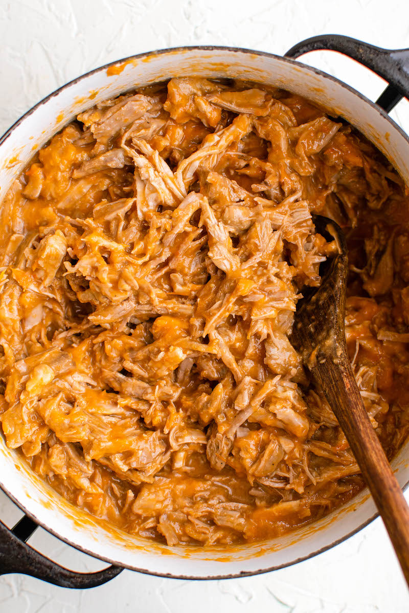 Red sauce mixed into shredded pork.