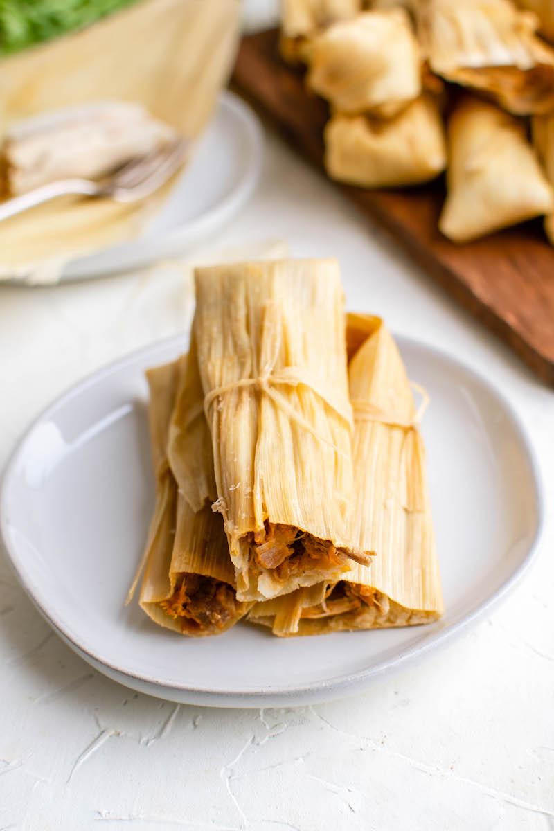 Plate of three pork tamales.