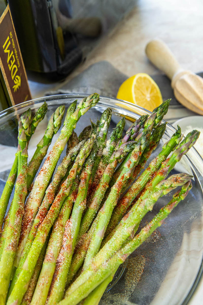 Asparagus stalks in a bowl.