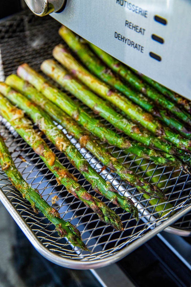 Asparagus on an air fryer rack.