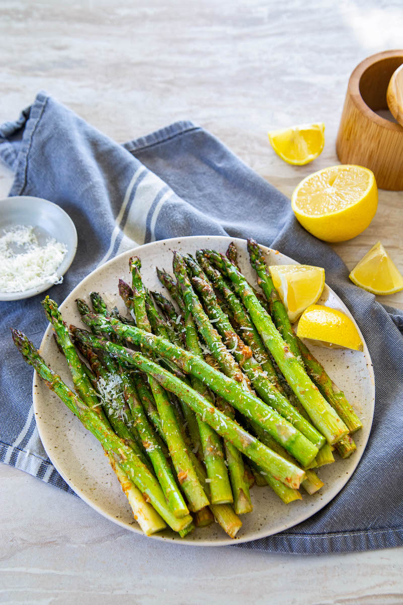 Asparagus on a plate with lemon.