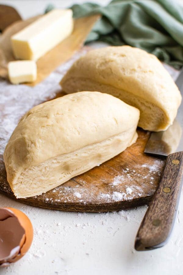 Sliced empanada dough on a cutting board.