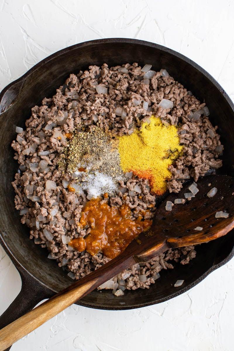 Browned ground beef with seasonings.