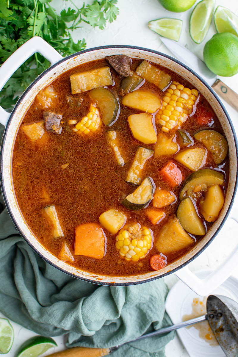 Pot of beef sancocho with vegetables.