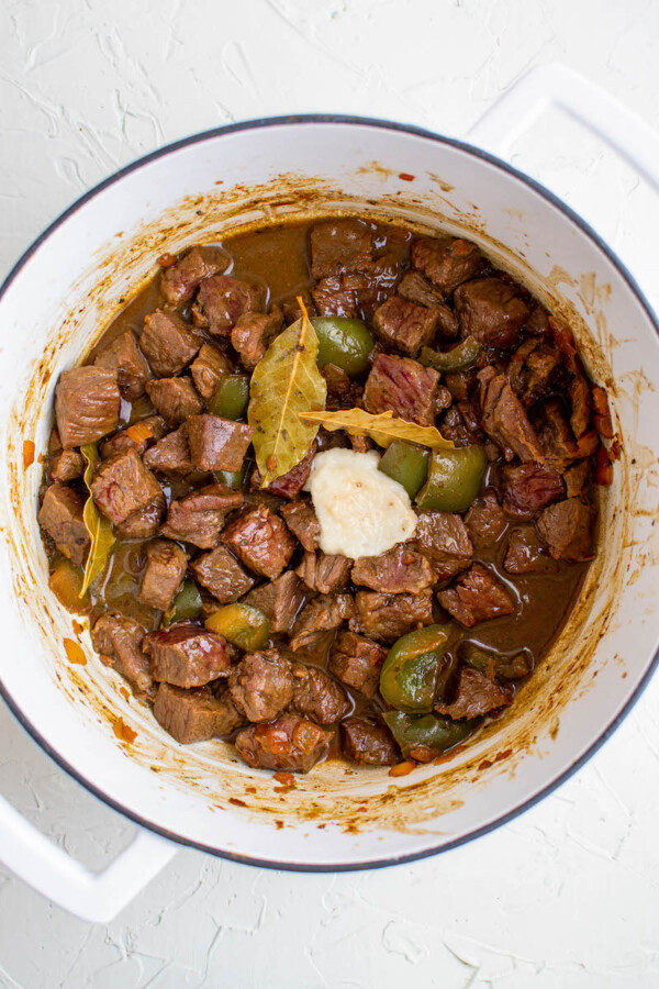 Browned beef in a pot.