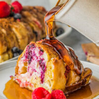 Berry stuffed french toast with maple syrup.