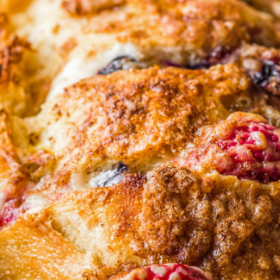 Up close image of Stuffed French toast in a baking pan.