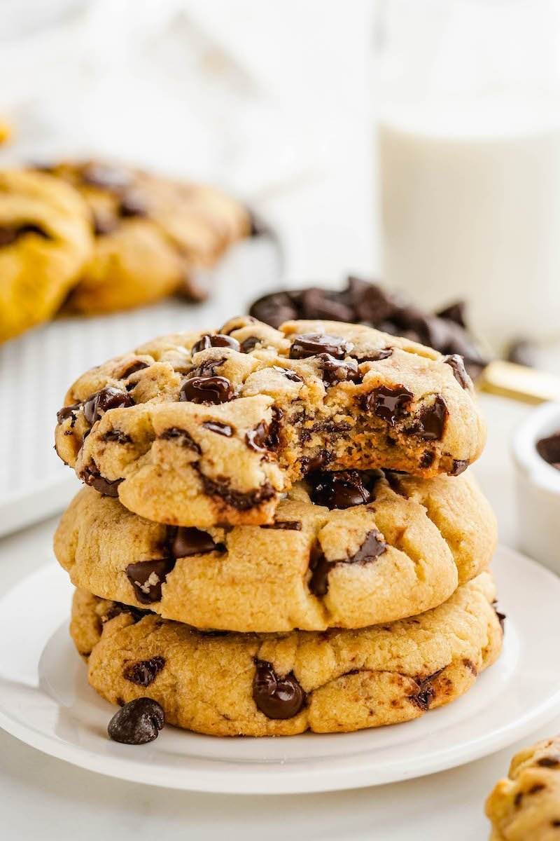 Stacked chocolate chip cookies on a plate.