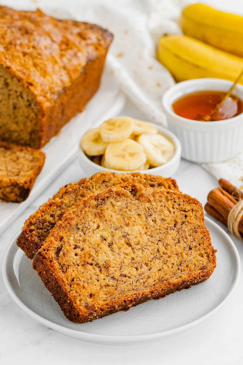 2 slices of banana bread on a plate.