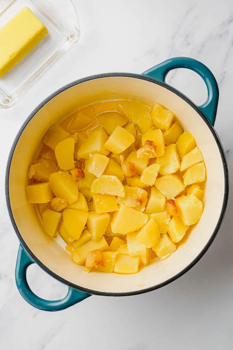 Pot of chopped potato cubes.