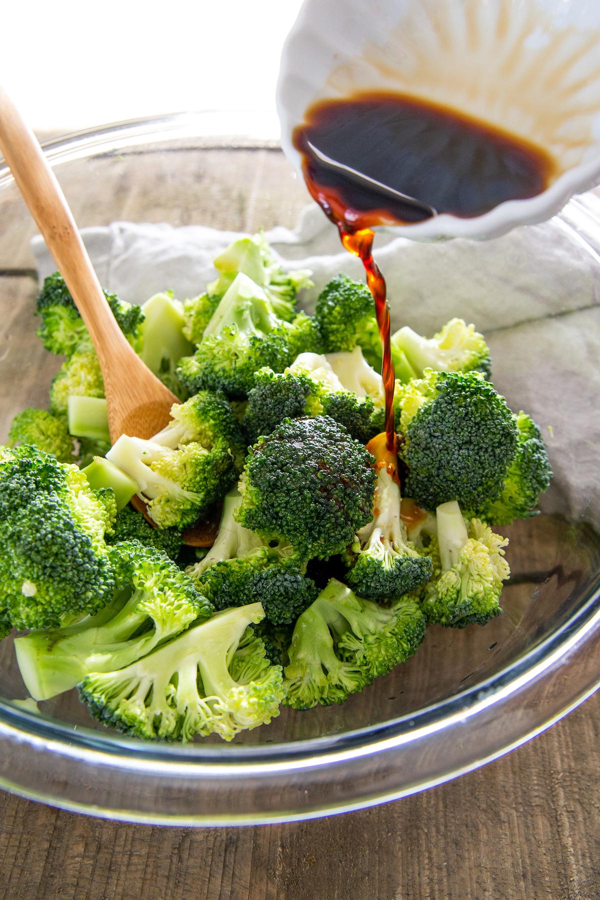 Seasoning mixture poured over broccoli florets.