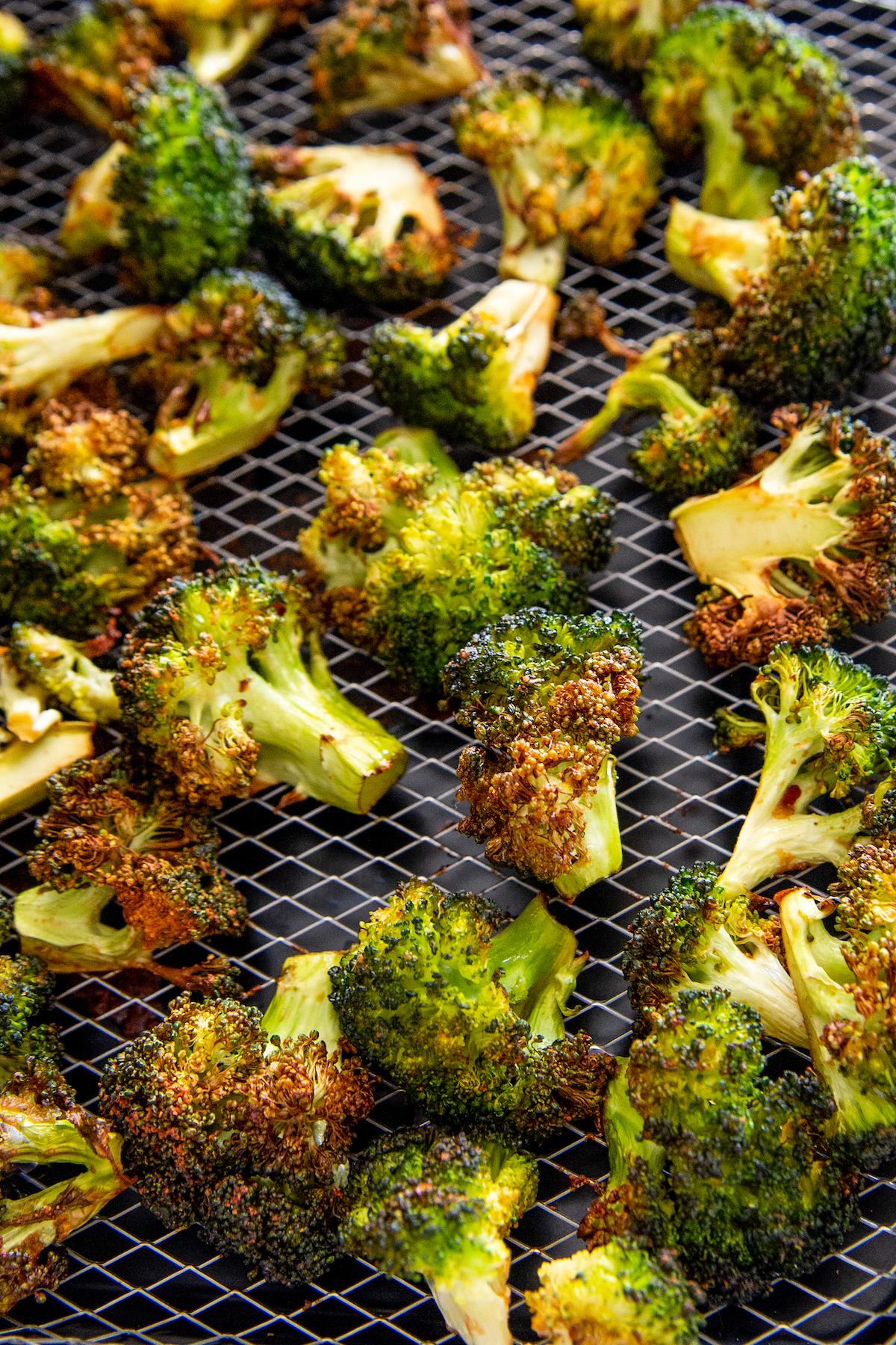 Asian roasted broccoli on an air fryer tray.