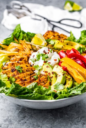 Serving bowl of air fryer chicken fajita salad.