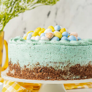 Easter egg cake on a cake platter.