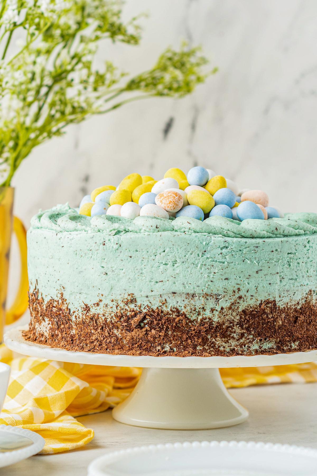 Easter egg cake on a cake platter.