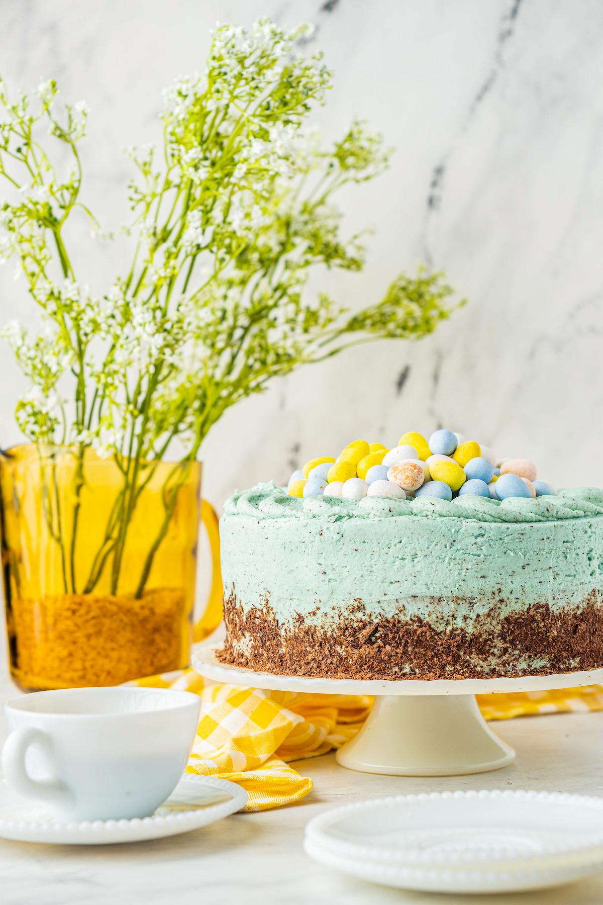 Easter egg cake sitting on a cake platter.
