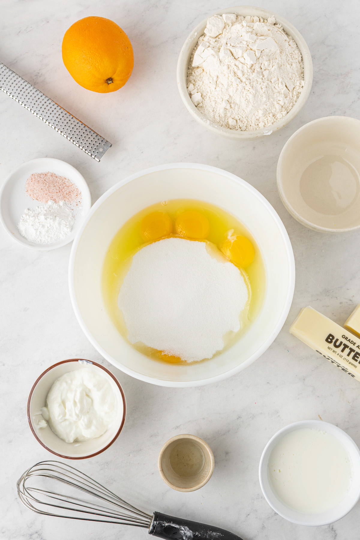 Eggs and sugar in a mixing bowl.