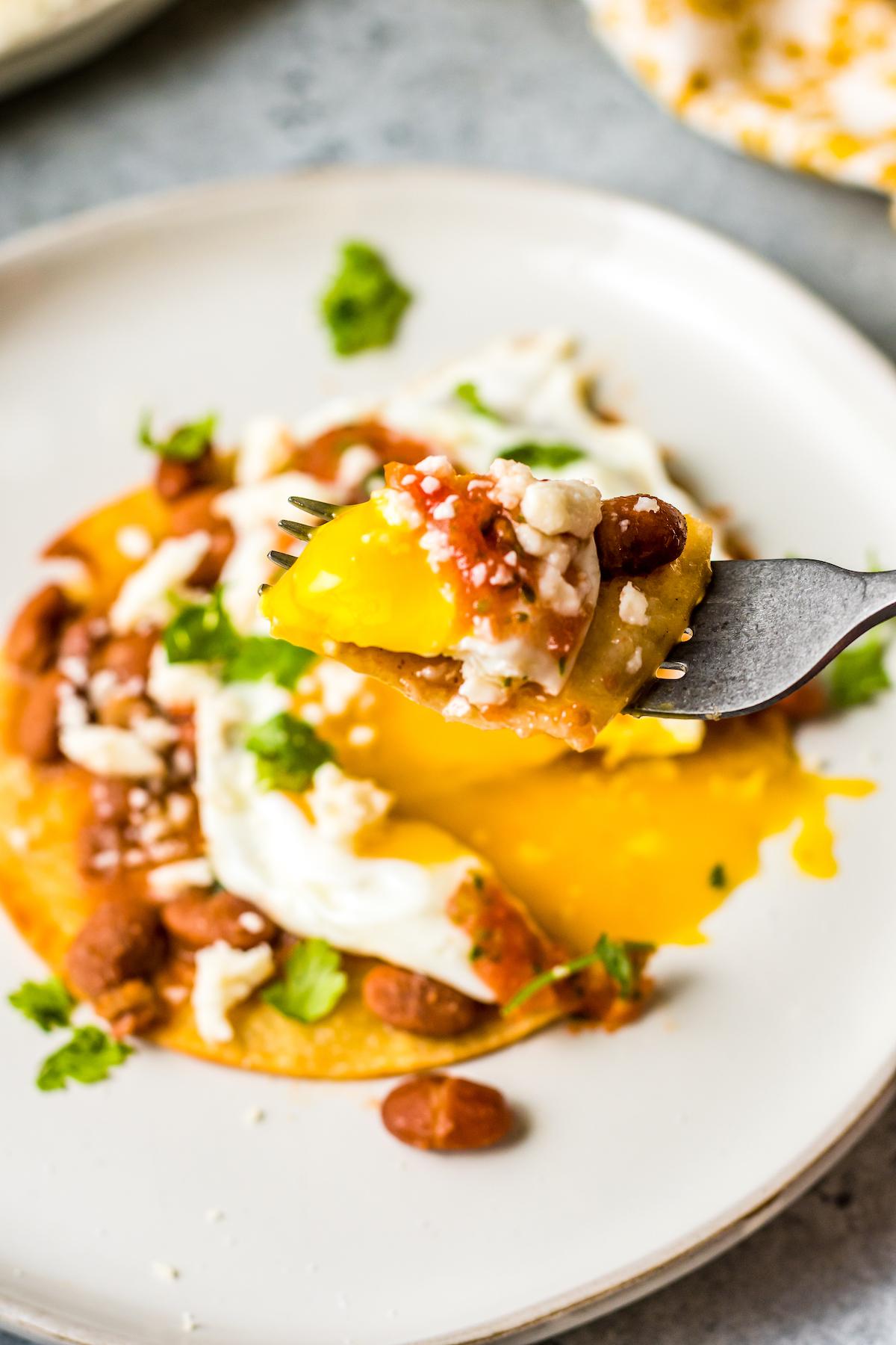 Huevos rancheros on a fork.
