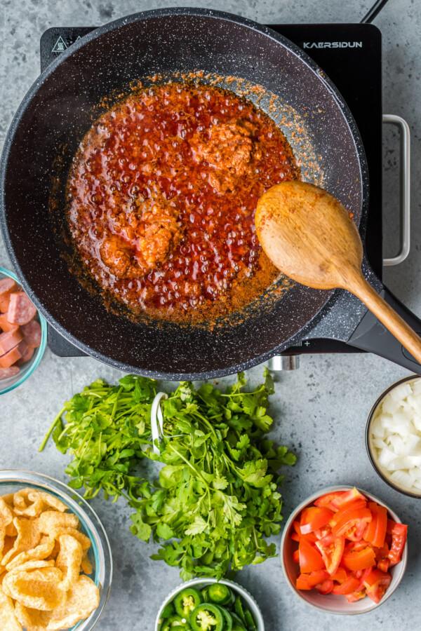 Chorizo cooking in bacon fat.